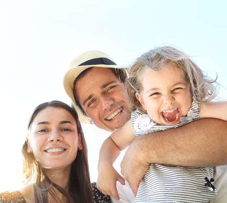 fun colors: Happy young family with little daughter outdoors Stock Photo
