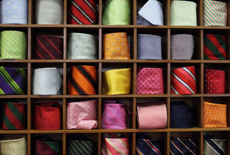 Ties on the shelf of a shop  photo