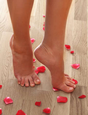 Beautiful legs of the woman and rose petals. Spa or pedicure concept Stock Photo - 10114811