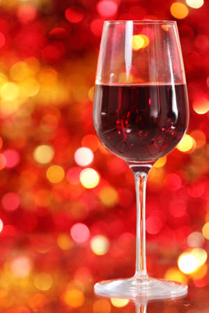 One glass of the red wine on the christmas background photo