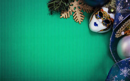Christmas card with carnival mask, Christmas ribbon, Christmas tree branches and Christmas balls. Paper with decorations and copy space photo