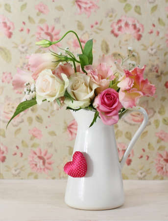 Bouquet of white and pink roses in the pot decorated by heart photo