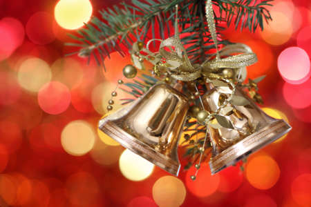 Golden Christmas tree decorations on lights background photo