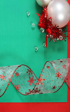Christmas card with Christmas ribbon and Christmas balls. Paper with decorations and copy space photo