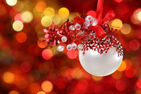Red and white Christmas tree decorations on lights background photo
