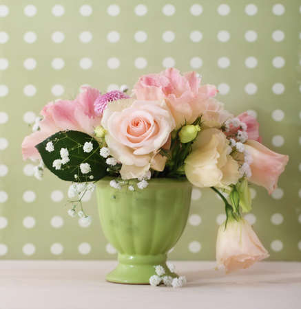 Bouquet of white and pink roses in the green vase Stock Photo