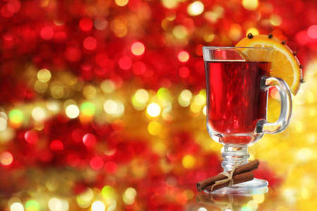 grog: Orange and cranberry punch with spices and Christmas decoration