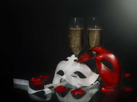 Carnival masks and christmas champagne on the black background