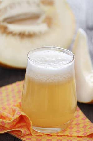honeydew: Honeydew melon fresh juice on wooden background