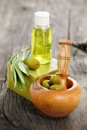 Organic cosmetics from olive oil on the wooden background Stock Photo