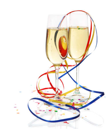 Champagne in two glasses with streamers over white background photo