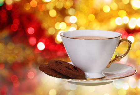 Cookies and tea on the blurred christmas background photo