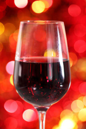 One glass of the red wine on the Christmas background