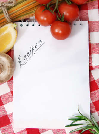 recipe: Vegetables still life with recipes blank on checkered background Stock Photo