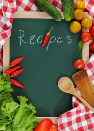 cook book: Vegetables still life with recipes blank on checkered background Stock Photo