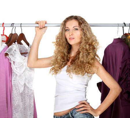 hanging woman: Portrait of a curly blonde beautiful girl selecting clothes
