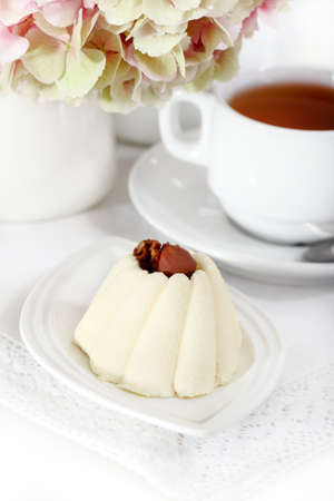 Delicious vanila cake with coffee on a white plate photo