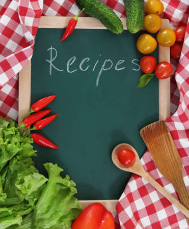 cookbook: Vegetables still life with recipes blank on checkered background Stock Photo