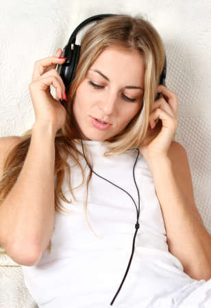 Portrait of the blond beauty smiling girl wearing headphones Stock Photo - 11211986