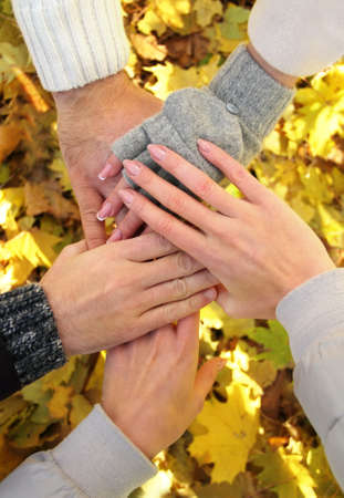 forever: Hands of best friends together outdoor. Autumn