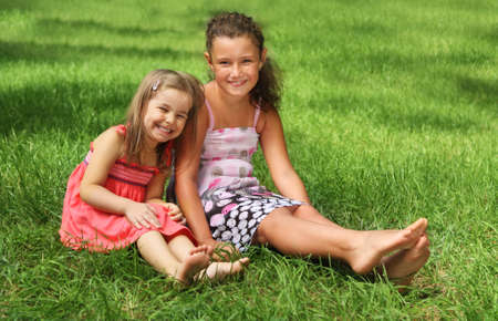 Two happy little girls having fun in the summer day photo