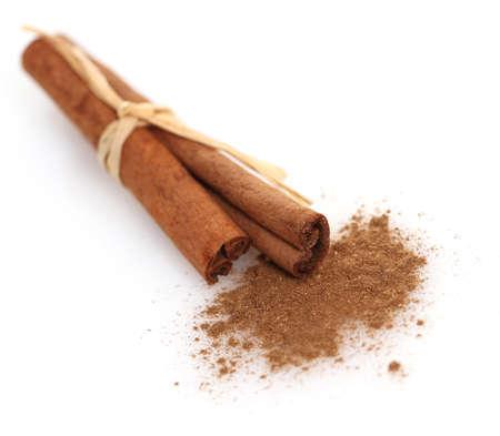 cinnamon bark: Cinnamon sticks and meal close up on white