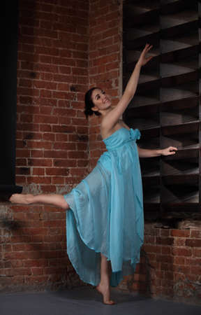 Young brunette woman dancing over brick walls Stock Photo - 12285179