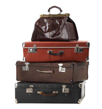 antique suitcase: Old vintage suitcases isolated on white. Luggage Stock Photo