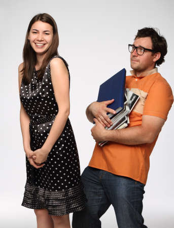 Portrait of a young beautiful funny couple in studio photo