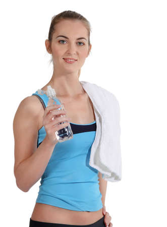 Attractive sporty woman with water and towel on white background  photo
