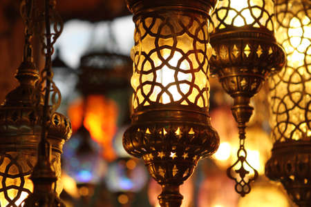night market: Traditional vintage Turkish lamps over light background in the night Stock Photo