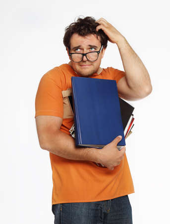 Young man in glasses holding bunch of books Stock Photo - 12636943
