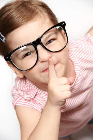 Portrait of lovely smiling little girl in glasses photo