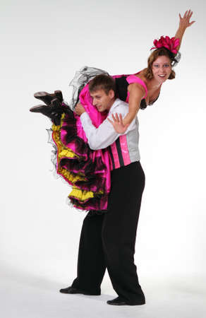 stage performer: Dancing couple in studio. Crazy character portrait. Cancan