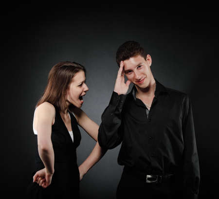 Portrait of a young couple screaming to each other Stock Photo - 12910112