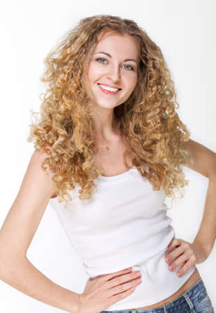 Portrait of the beautiful blond girl with curly hair in white Stock Photo - 12910154