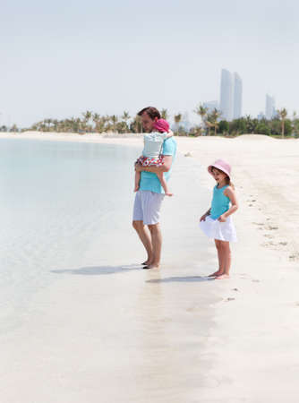 Father and his two little daughters enjoying vacation photo