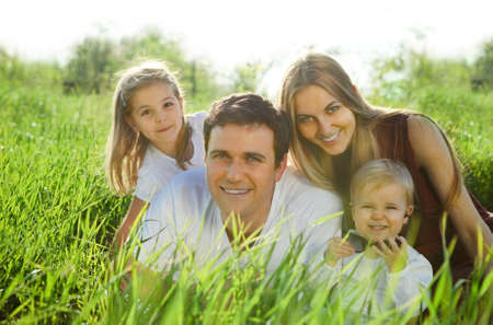 Happy young family with children outdoors photo