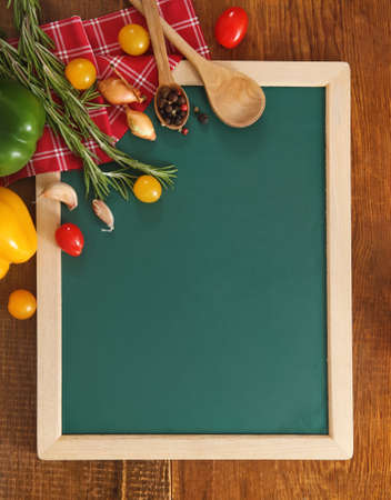 Vegetables still life with green board with copy space photo