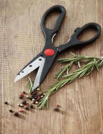 Still life with fresh rosemary, scissors and peppers Stock Photo - 13816433