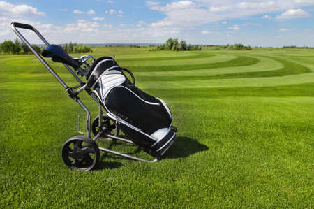 Golf clubs in golfbag and golf balls green grass background photo