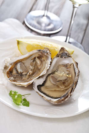 Two fresh oysters platter served with white wine photo