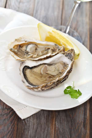 Two fresh oysters platter served with wine photo