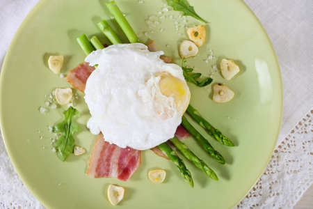 Salad with green asparagus with poached egg and ham Stock Photo - 14357886