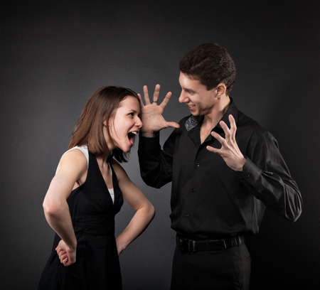 cheat: Conflict situation between couple  Over dark background