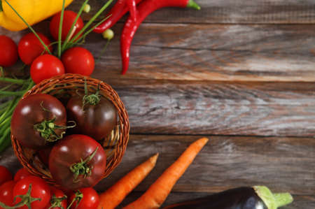 Vegetables still life in wooden background with copy space photo