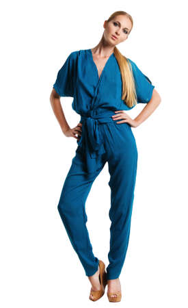 Portrait of the beautiful blonde girl in long blue overalls photo