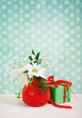 Bouquet of winter flowers with present decorated with ribbon Stock Photo - 15167116