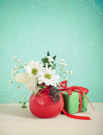 Bouquet of winter flowers with present decorated with ribbon Stock Photo - 15167119