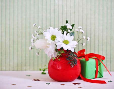 Bouquet of winter flowers with present decorated with ribbon Stock Photo - 15167124